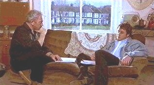 Michael Ball as Purcell, speaks directly to Charles (Simon Callow) in his 1960s apartment.